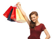 Happy teenage girl with shopping bags — Stockfoto