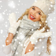 Beautiful woman in hat, muffler and mittens - Stock Photo