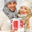 Romantic couple in a sweaters with gift box - Stok fotoğraf