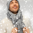 Handsome man in warm sweater, hat and scarf - Stock Photo