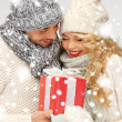 Romantic couple in a sweaters with gift box — Stock Photo #17390583