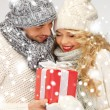 Romantic couple in a sweaters with gift box - Stock Photo