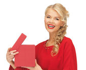 Lovely woman in red dress with opened gift box — Stock Photo