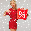 Lovely woman in red dress with percent sign — Stock Photo