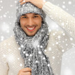 Stock Photo: Handsome min warm sweater, hat and scarf