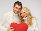 Family couple in a sweaters with heart — Stock fotografie