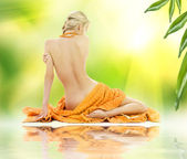 Beautiful woman in spa with towels — Stock Photo