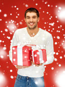 Man holding many gift boxes — Stock Photo