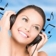 Happy woman in headphones — Stock Photo #17503173