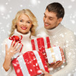 Romantic couple in a sweaters with gift boxes — Stock Photo #17508821
