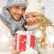 Royalty-Free Stock Photo: Romantic couple in a sweaters with gift box