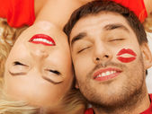 Happy couple lying at home with closed eyes — Stock Photo