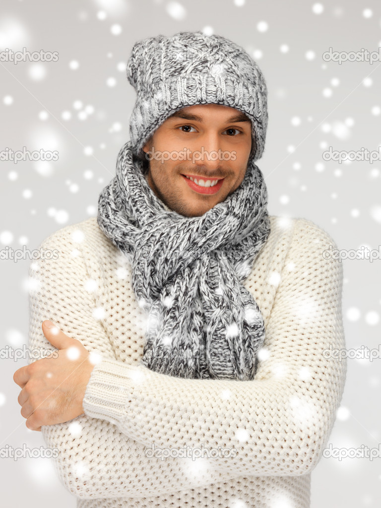 Picture of handsome man in warm sweater, hat and scarf. — Stock Photo #17508719