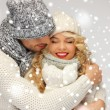 Family couple in winter clothes — Stok Fotoğraf #17613739