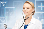 Attractive female doctor with stethoscope — Stock Photo
