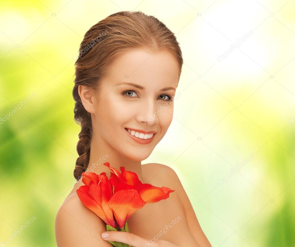 Picture of beautiful woman with red lily flower — Stock Photo #17612637