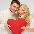 Family couple in a sweaters with heart — Stock Photo