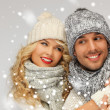 Family couple in winter clothes — Stok Fotoğraf #17662575