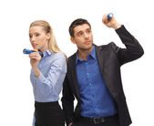 Man and woman with flashlights — Stock Photo