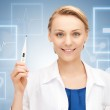 Attractive female doctor with thermometer — Stock Photo #17702377
