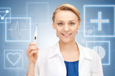 Attractive female doctor with thermometer — Stock Photo