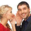 Stock Photo: Man and woman spreading gossip
