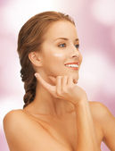 Beautiful woman with moisturizing creme drop — Stock Photo