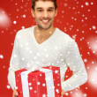 Stock Photo: Handsome man with a gift