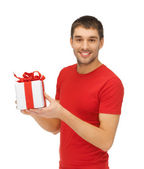 Handsome man with a gift — Stock Photo
