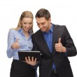Man and woman with tablet pc — Stock Photo