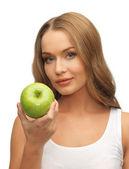 Kobieta z zielonym jabłkiem — Zdjęcie stockowe