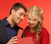 Man and woman looking inside the gift box — Stock Photo