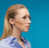 Businesswoman in protective glasses — Stock Photo