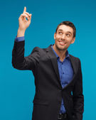 Man in suit with his finger up — Stock Photo