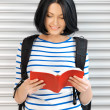 Woman with bag and book — Foto de Stock