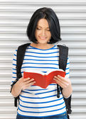 Woman with bag and book — Stock Photo