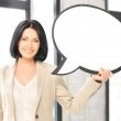 Smiling businesswoman with blank text bubble — Stock Photo #18725213