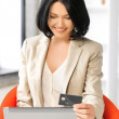 Happy woman with laptop computer and credit card — Stock Photo #18725293