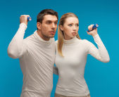 Man and woman with pocket flashlights — Stock Photo