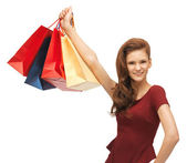 Happy teenage girl with shopping bags — 图库照片