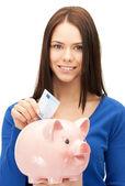 Krásná žena s prasátko a peníze — Stock fotografie