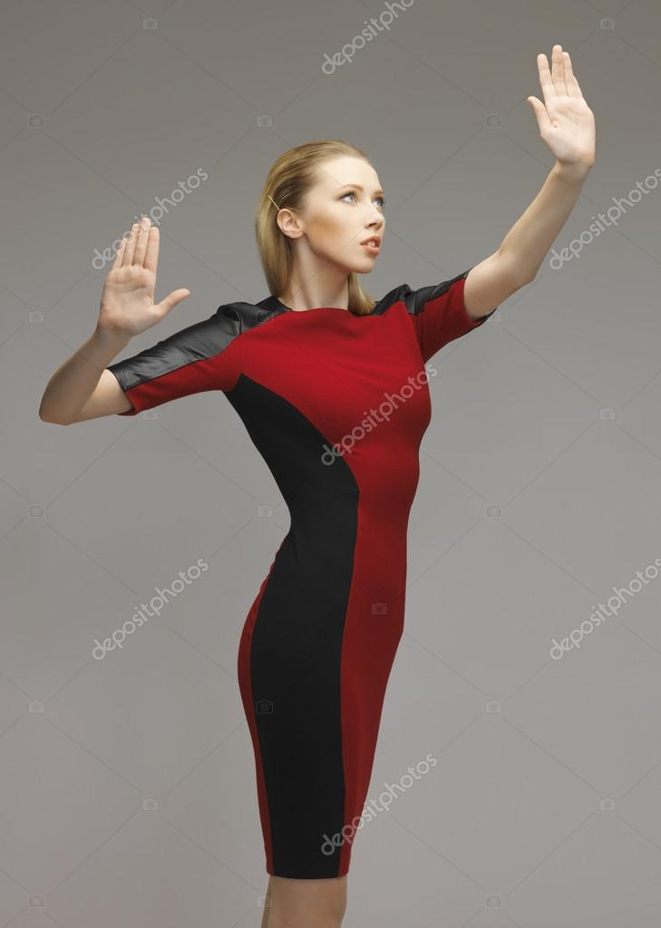 Picture of futuristic woman working with something imaginary  Foto de Stock   #18726477