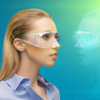 Woman in 3d glasses with hologram — Stock Photo #18898505