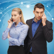 Man and woman with cell phones — Stock Photo #18898537