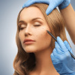 Woman face and beautician hands — Stock Photo #18898679