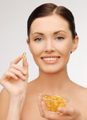 Woman with vitamins — Foto de Stock