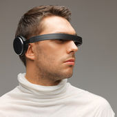 Man with futuristic glasses — Stock Photo
