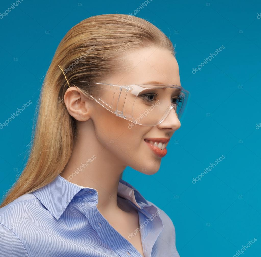 Bright picture of businesswoman in protective glasses  Stock Photo #18900345