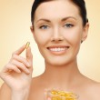 Woman with vitamins — Stock Photo