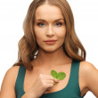 Woman with spinach leaves — Stock Photo